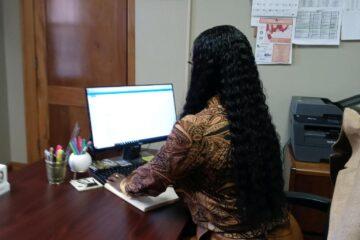 Kirsten Gladen sitting at desk