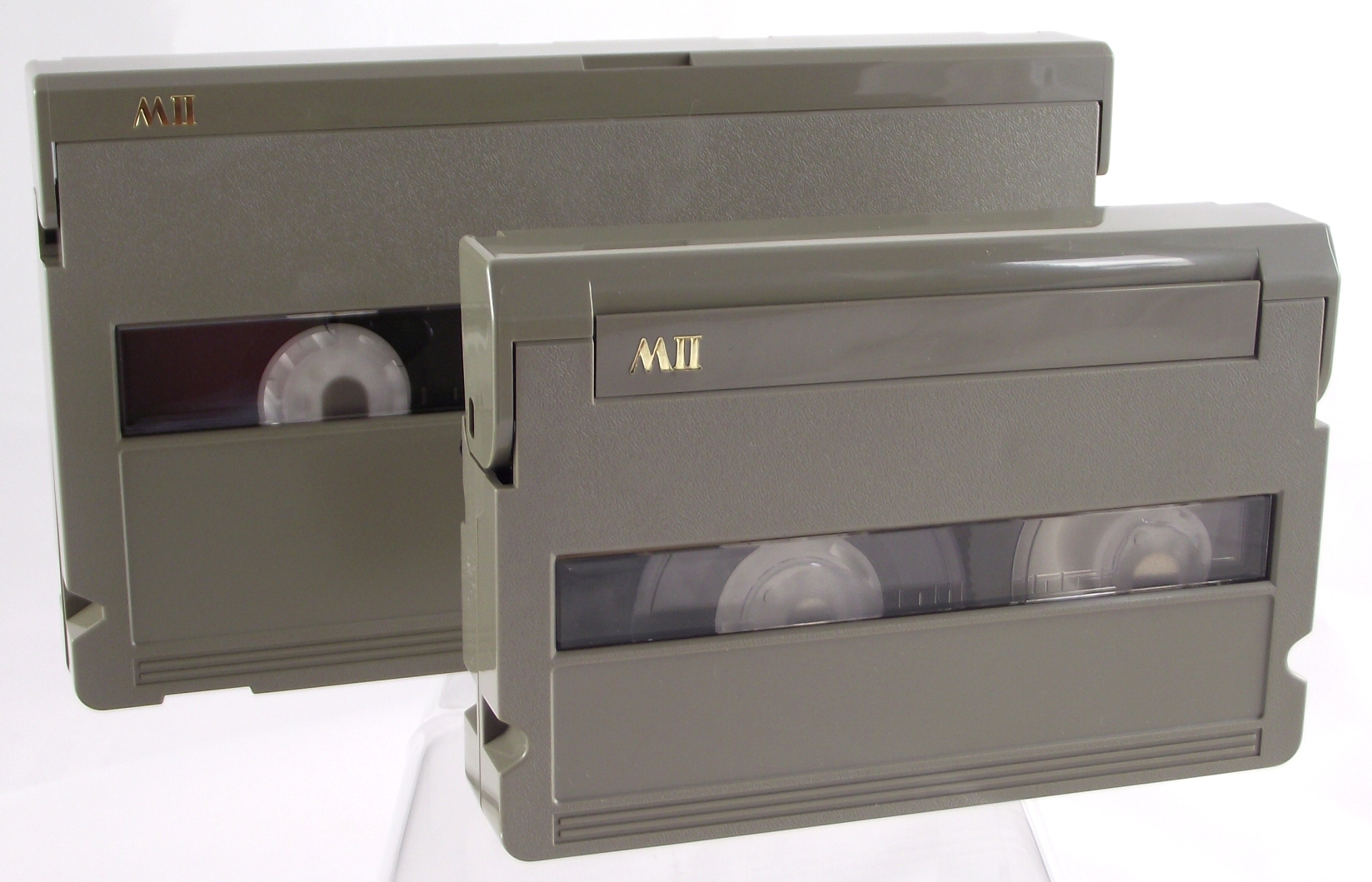 Size comparison between the two MII tape formats. Large versus compact.