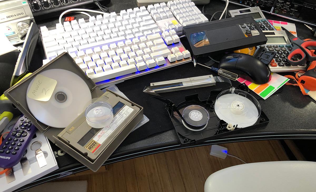 Transferring MII tape spools into VHS tape shells.