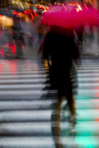 Rushing Red Umbrella • ©Pierre Hauser