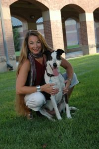 Me (Victoria M. Young) pictured in 2009 with Miss Mia. Since then my hair has gathered wisdom highlights (silver), the dog has slowed down a bit, but the education reform war remains relentlessly unfaltering.