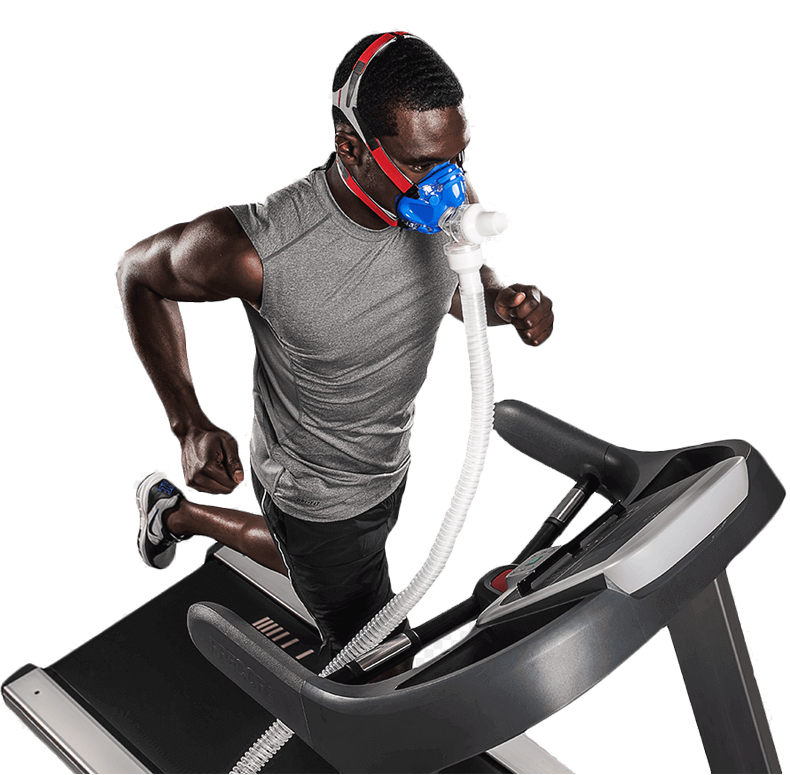 Man running on treadmill while undergoing a VO2 Max Test with head gear