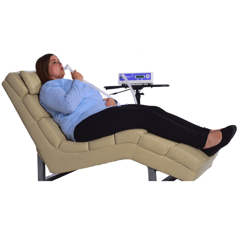 Woman resting and reclining in lounge chair while performing her RMR test