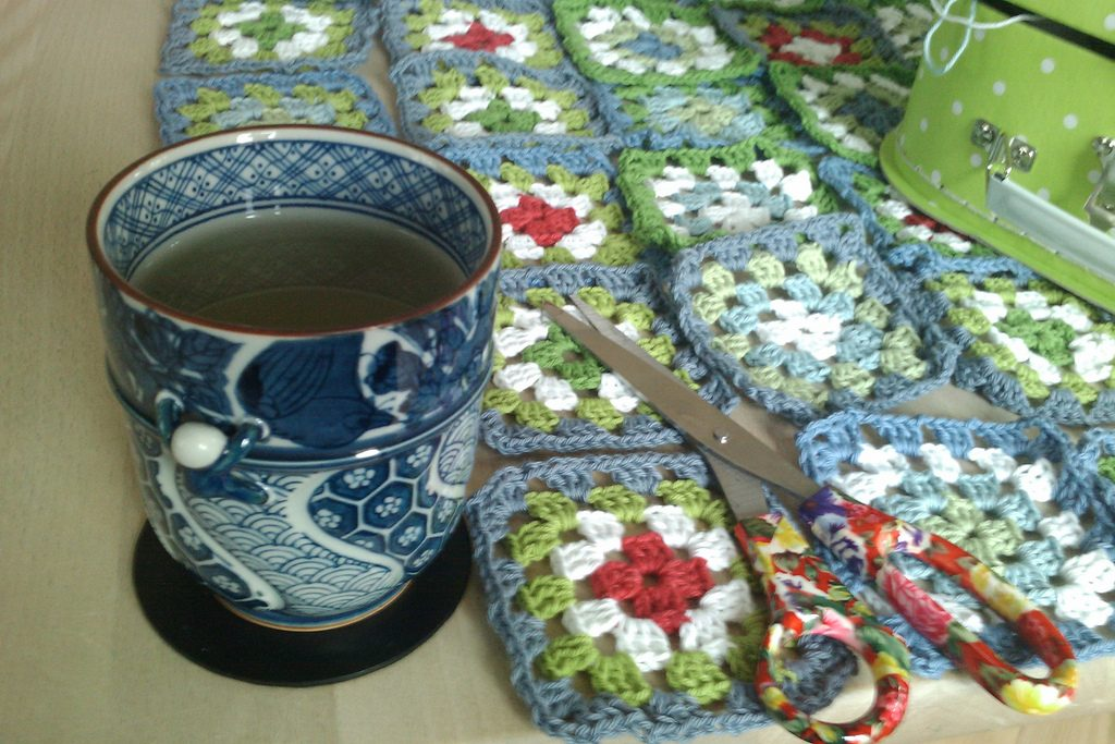 China cup of tea, floral scissors and quilt