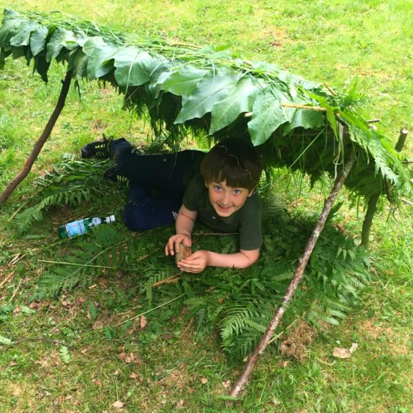 Boy under natural shelter