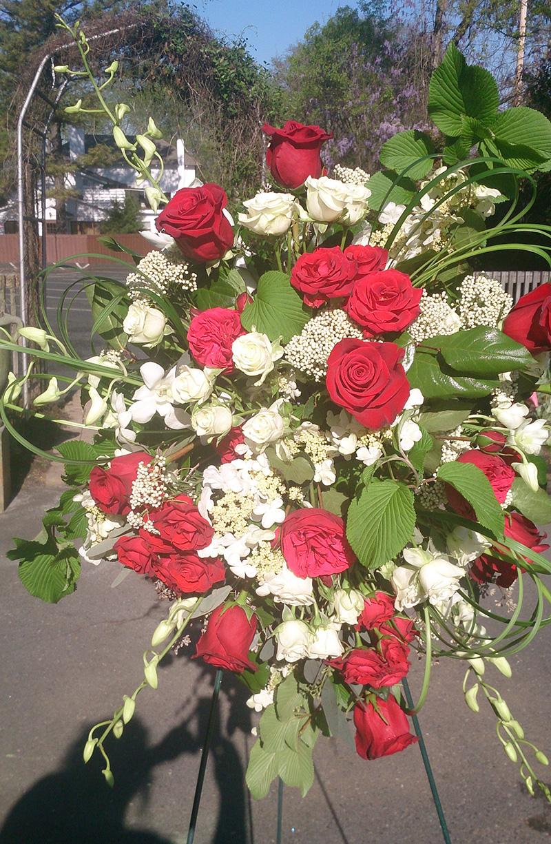 Sympathy Arrangement Standing Spray Red Roses