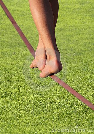 slackline-feet-over-grass-17229724.jpg