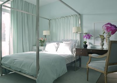 bedroom with table chair and flower