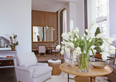 living room with chairs and flowers