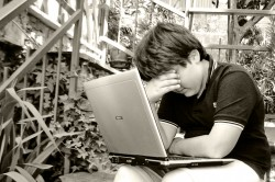 An upset person with a laptop