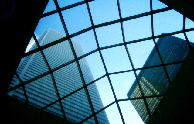 Looking up at a high rise buildings