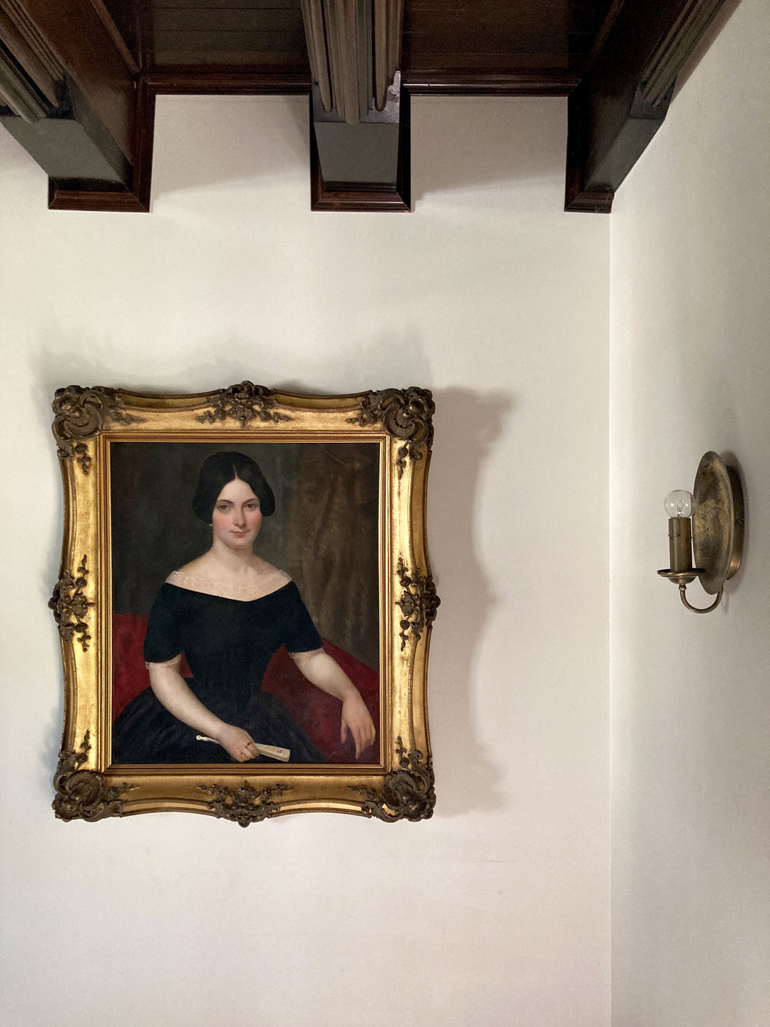 Antique frame restoration antique frame repair Frame touch up Painting conservation Painting of female with fan Nineteenth century portrait Gold leaf frame treatment cleaning of gilt frames Victorian frames Art installation Museum framing Casting of moulding cast ornamentation