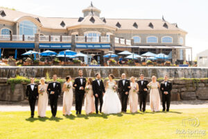 wedding bridal party with saratoga national in the background