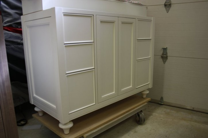 white face framed furniture style vanity with bun foot