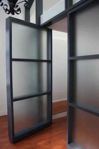 glass wall with pivot doors