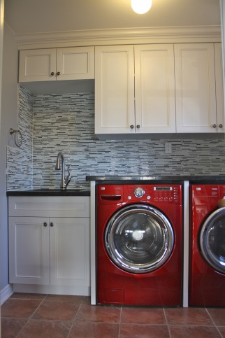 white laundry room cabinetry