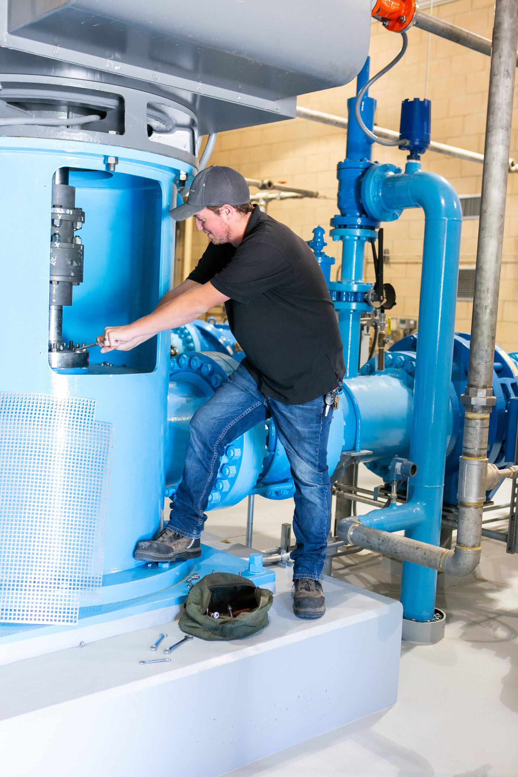 San Bernardino Valley Municipal Water District employee repairing pipe