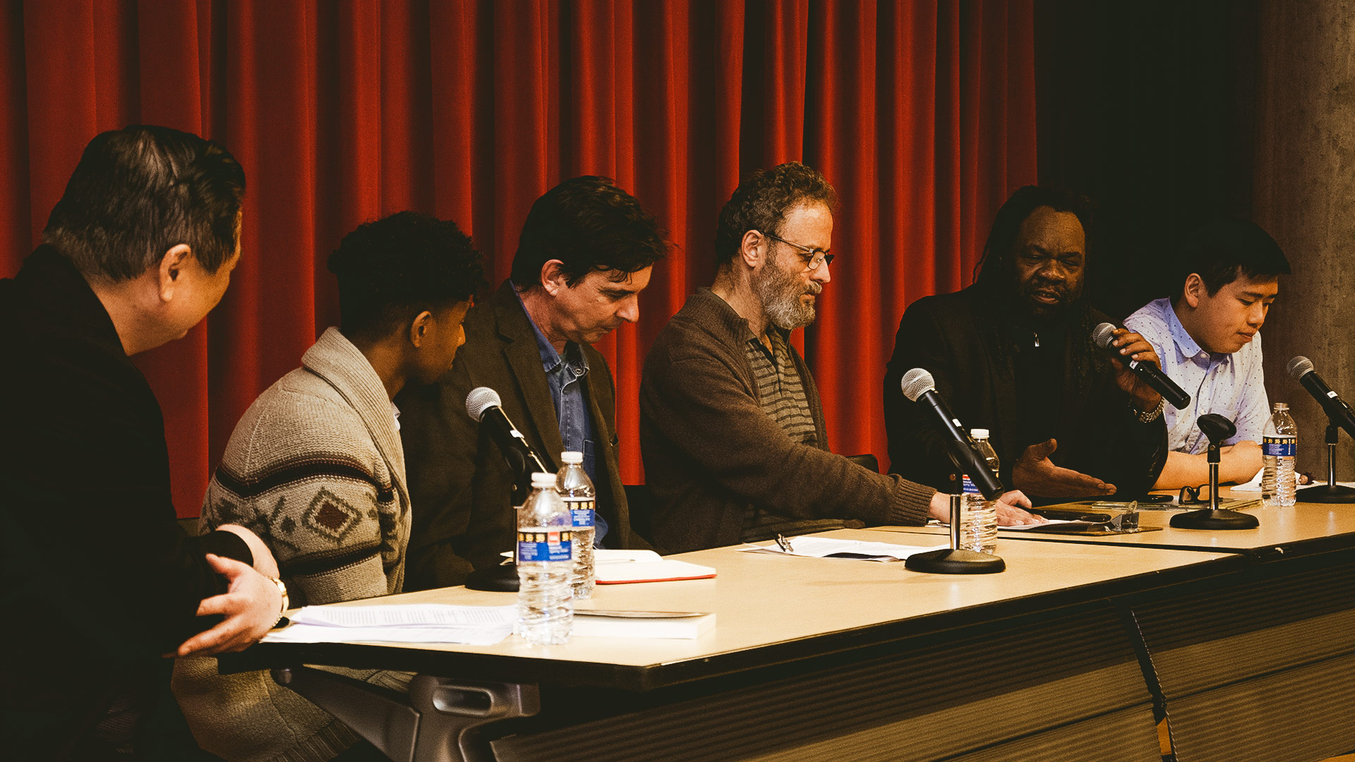Panel of men speaking