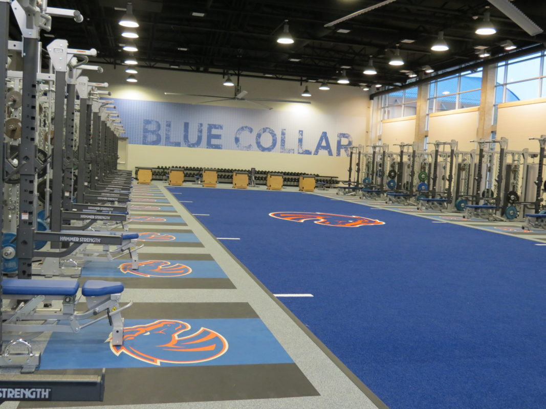 Wall and floor graphics at a Boise State Football Training facility