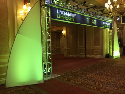 green archway with banner graphics