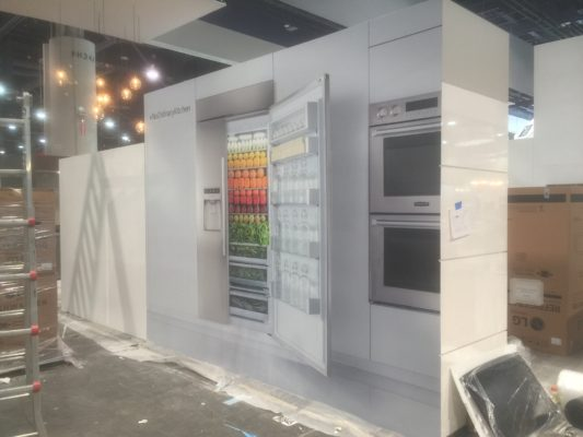 trade show display with a refrigerator and graphics