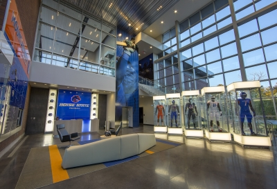 football suits in glass cases and wall graphics