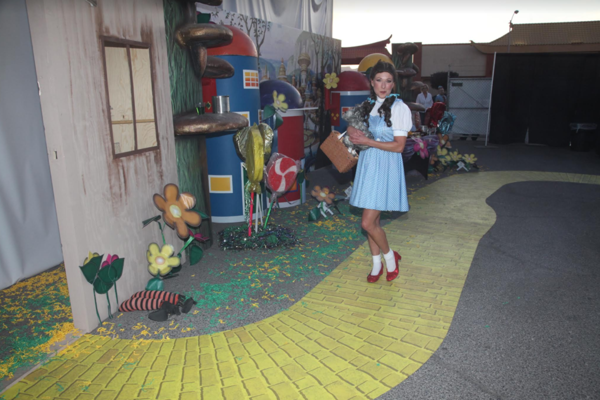 woman in red shoes on a yellow brick road