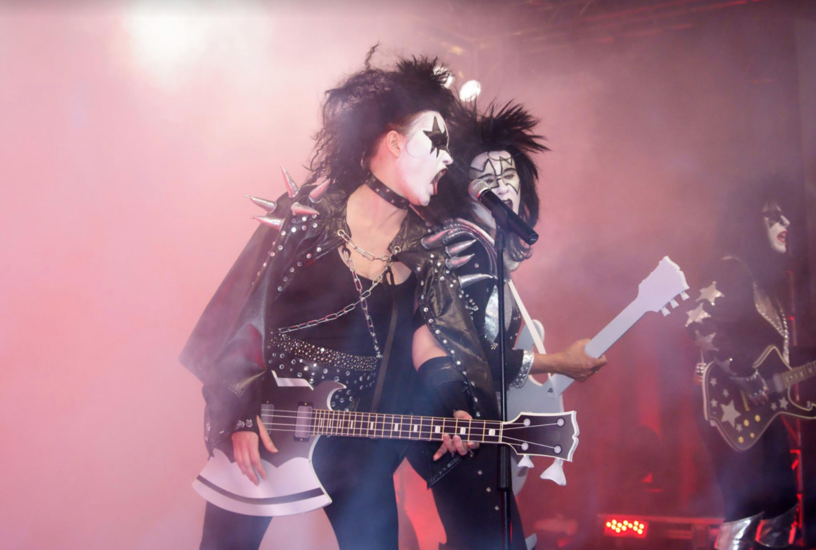 rock group in face paint on stage