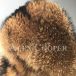Real raccoon fur winter outerwear with stylish hood for women close view