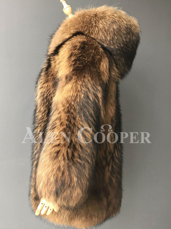 Real raccoon fur winter outerwear with stylish hood for women side view