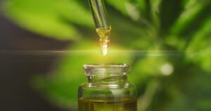 Nature's Green House explains the differences between hemp and CBD oils they offer while a specialist uses a dropper to fill a tincture bottle