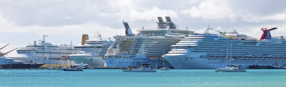PHILIPSBURG, ST. MAARTEN - JAN.16: Cruise ships docked on the Dutch side of St. Maarten on Jan. 16, 2013. Philipsburg is one of the busiest islands as the port can accommodate half dozen ships.