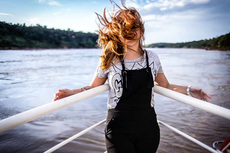Canva - Woman Wearing Gray Shirt and Black Overalls on Boat