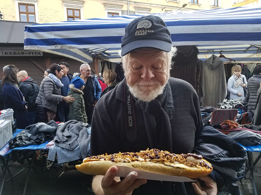 Tom holding hotdog in Krakow Poland