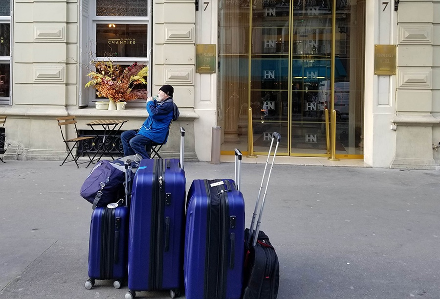 Tom with luggage in Paris