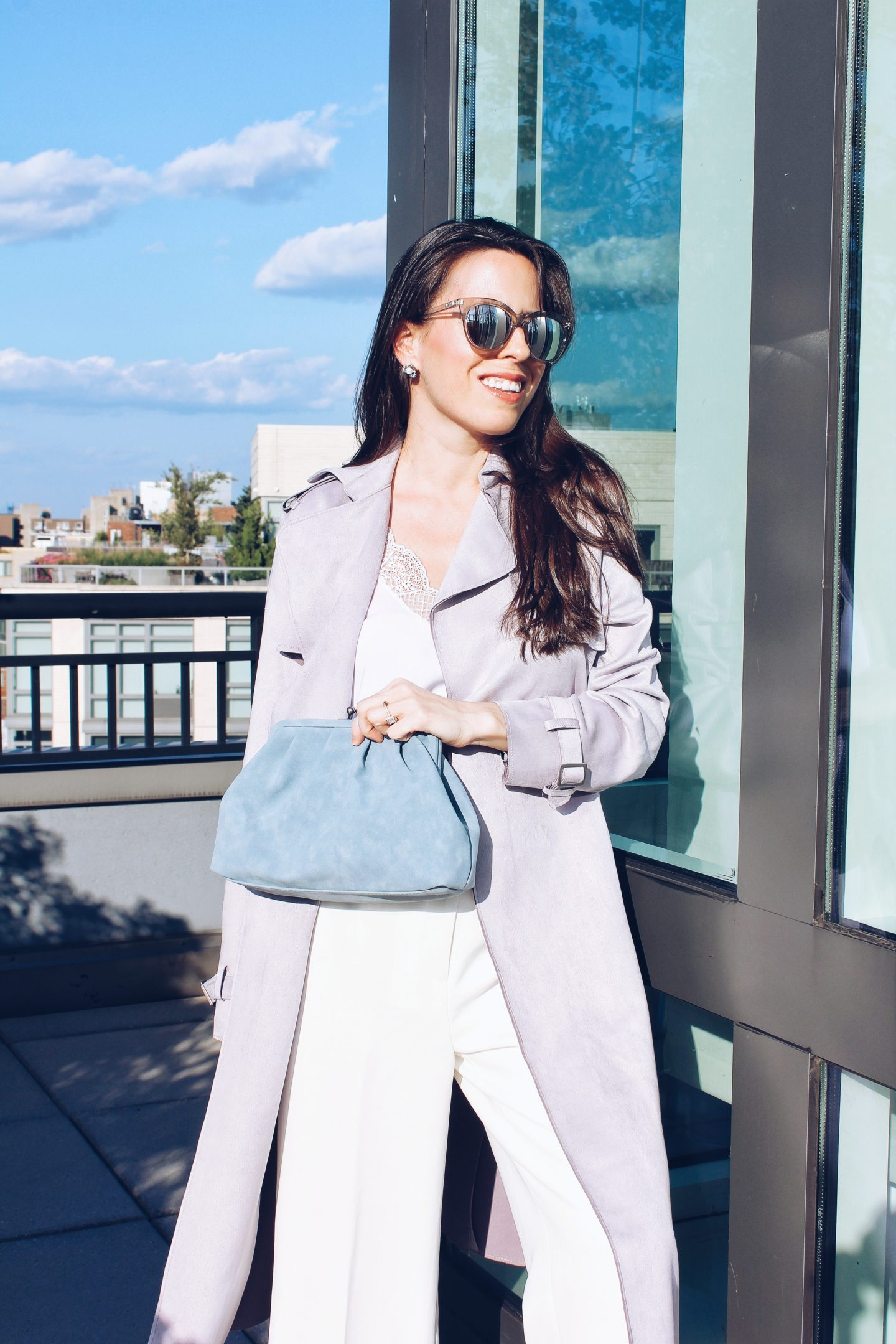 New York fashion blogger Ana Florentina wearing lilac trench coat