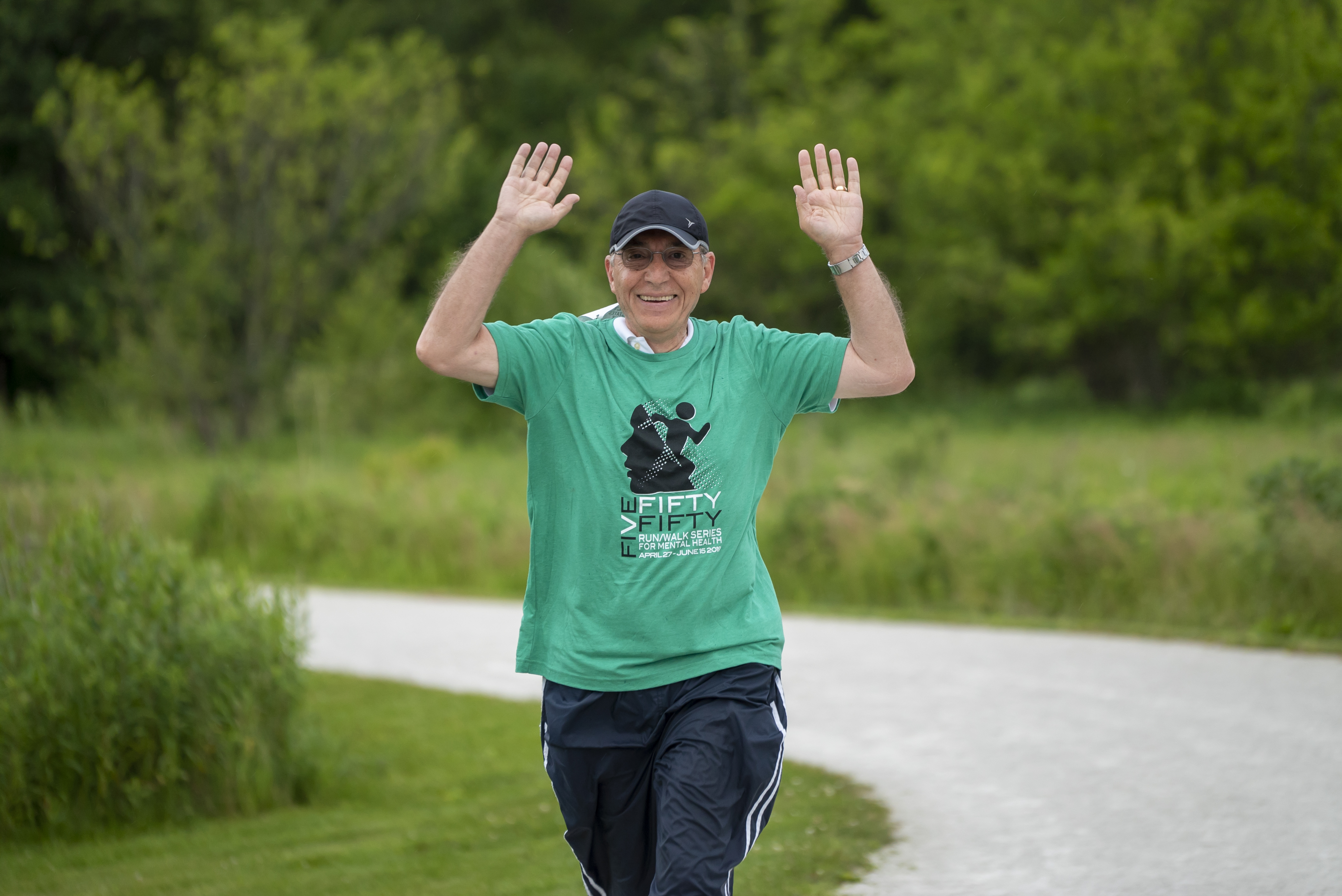 Man running in Five Fifty Fifty tee shirt