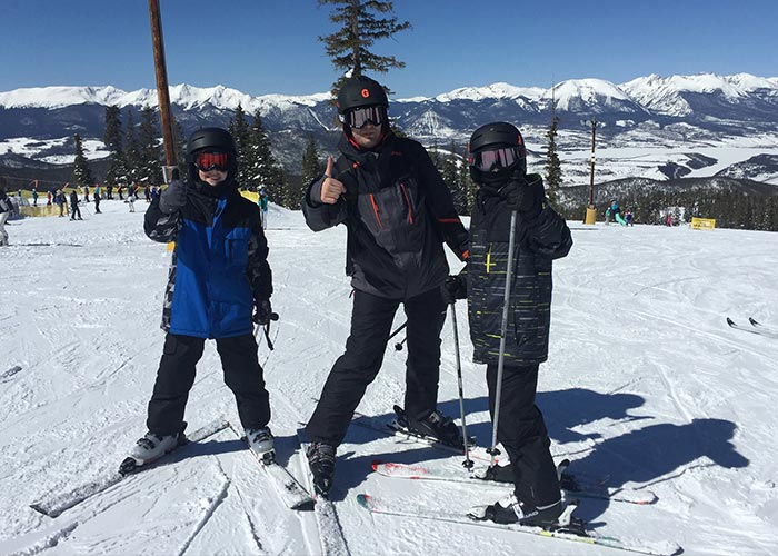 Greg skiing with his twins
