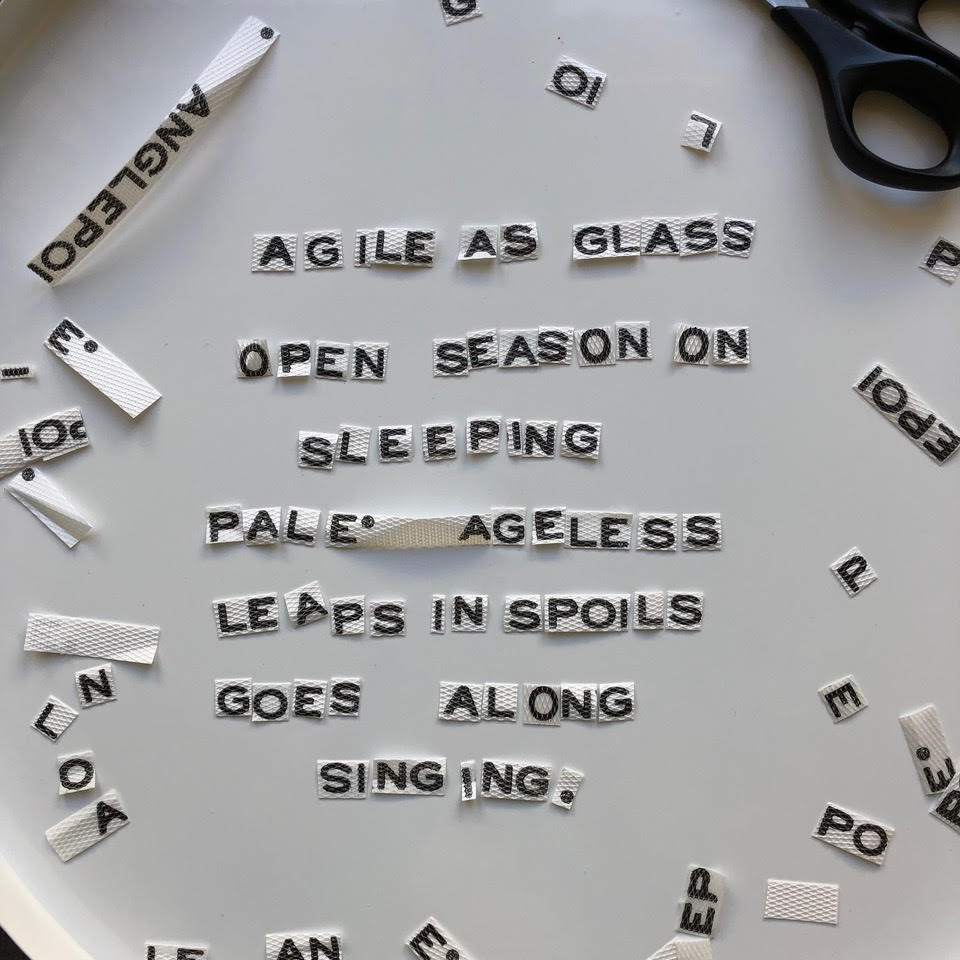 Cut-up letters and words creating a found poem