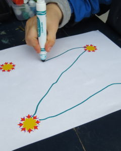 Students practice letter strokes