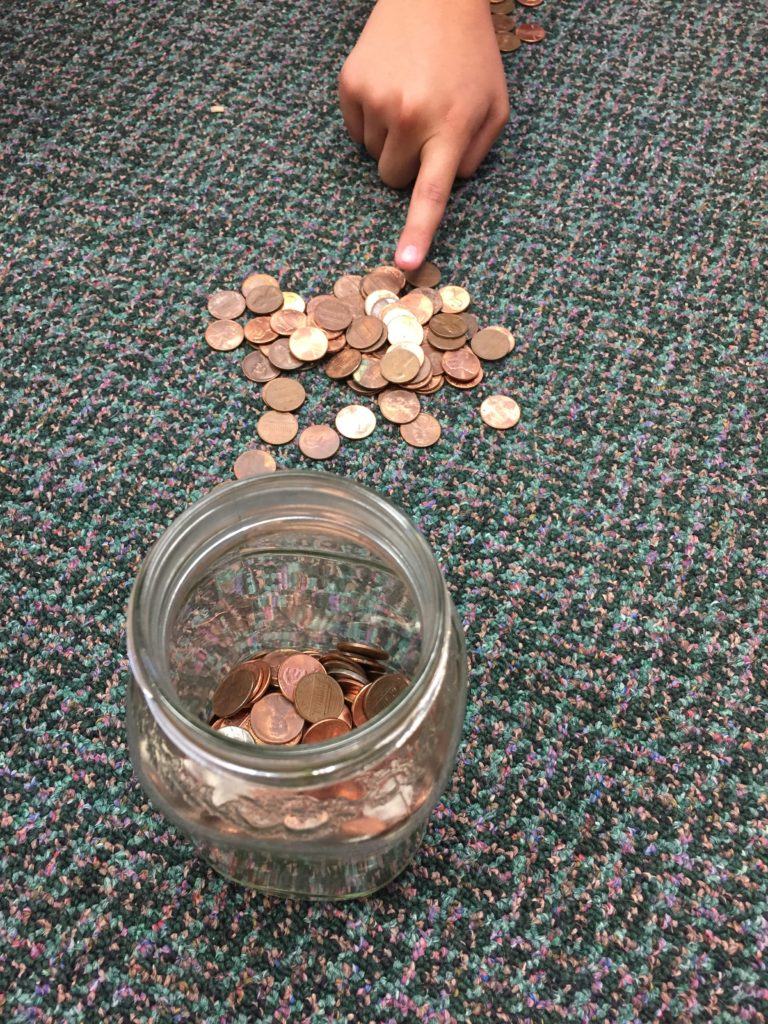 A child counts pennies