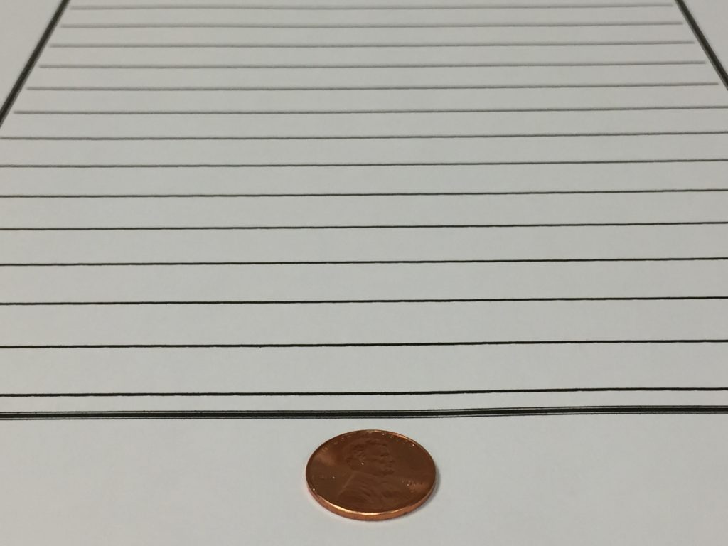 a penny glued to the bottom of the student's paper
