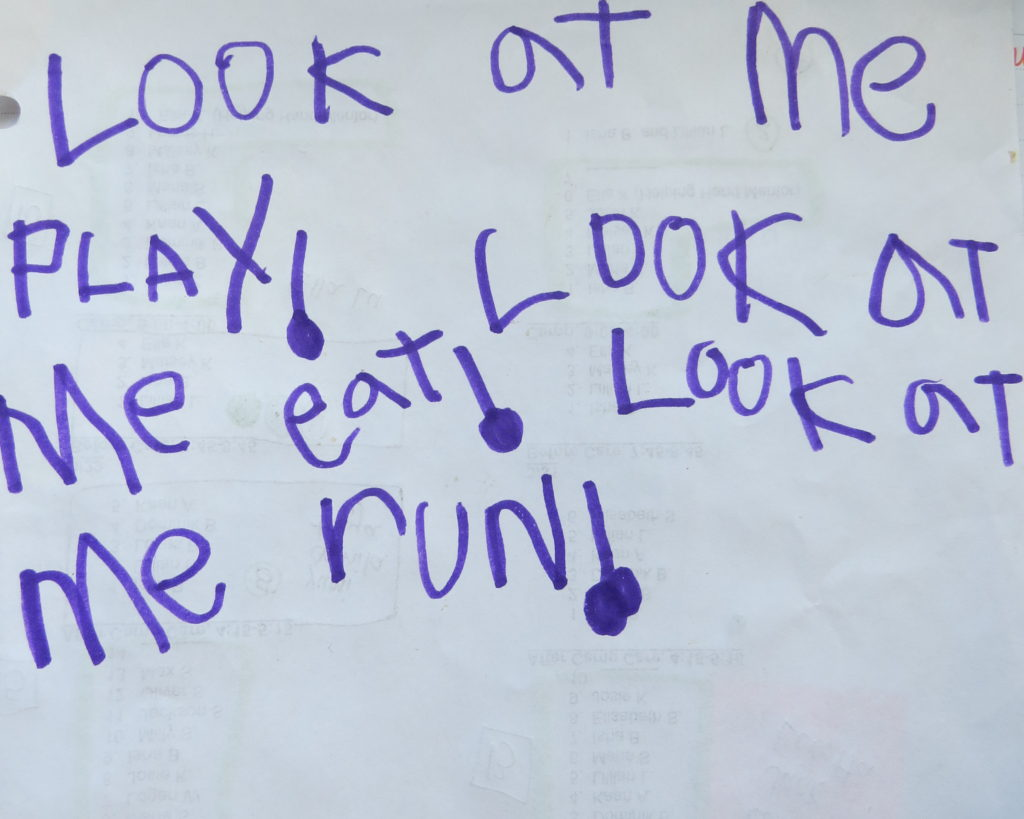 "The sight word sentences, ""Look at me jump"" written three times.  The word jump is changed each time."