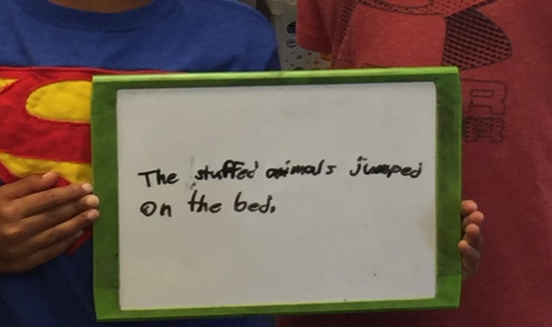 A personification sentence on a whiteboard