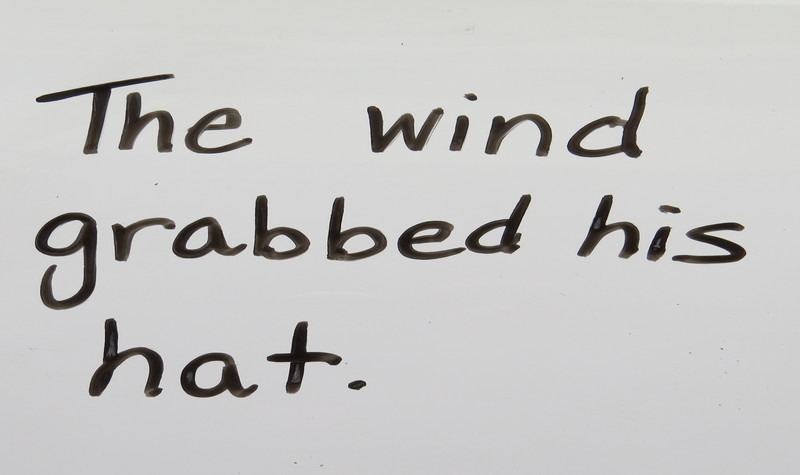 """The sentence, """"The wind grabbed his hat."""""""