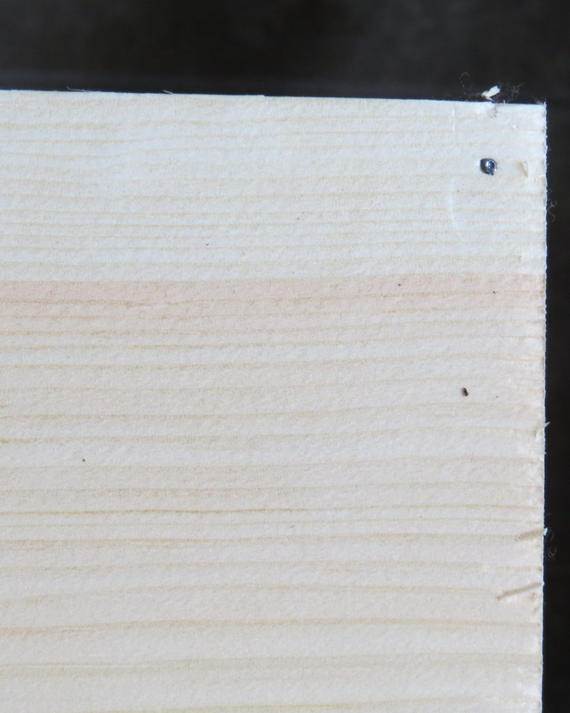 nails hammered into the wood