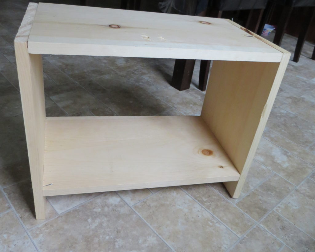 a finished wooden shelf