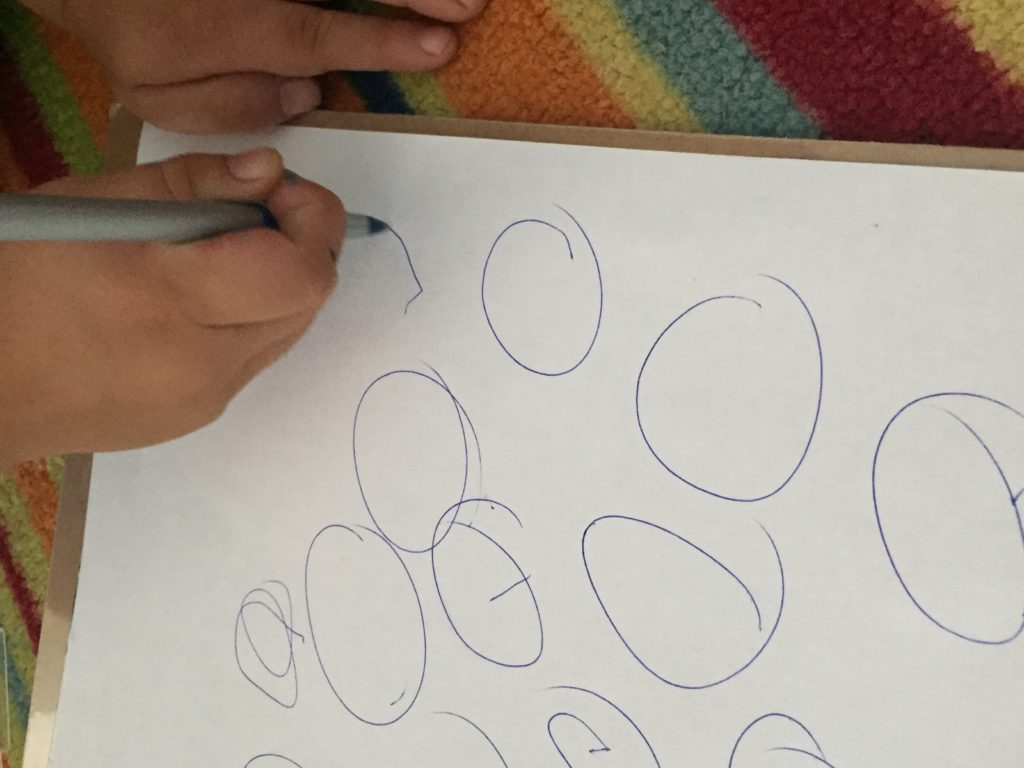 Child writing circles