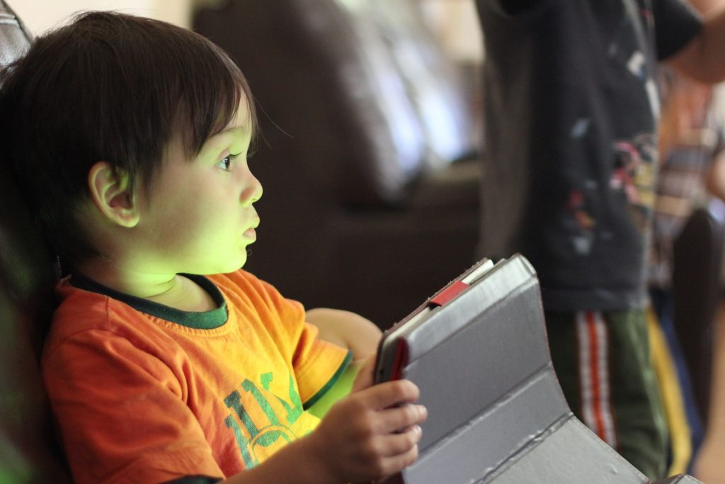 Child using an I-Pad