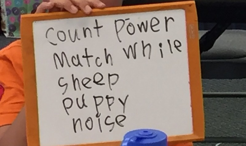 Children writing words with 5 letters